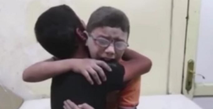Heartbreaking video shows Syrian boys grieving death of brother killed in airstrike
