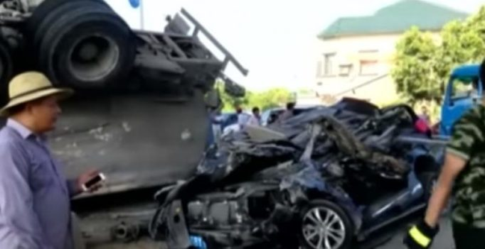 Video: Couple miraculously survives after car is crushed by cement truck