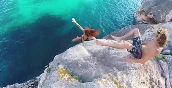 Video: Man refuses to help girlfriend, lets her fall off cliff