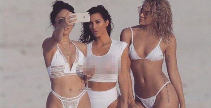 Kim Kardashian flashes nipples in transparent white bikini