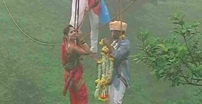 Crazy in love: Indian couple ties knot dangling mid-air at 295ft