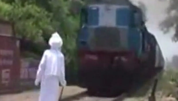 Watch: Shocking video of an old man challenging a speeding train