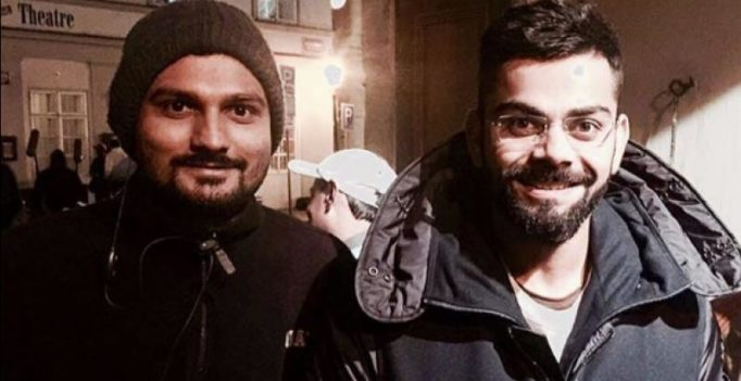 Spotted: Anushka goes behind the lens to click Virat's picture with fan in Prague!