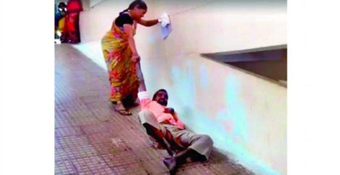 Desperate wife drags man up hospital floor in Andhra Pradesh