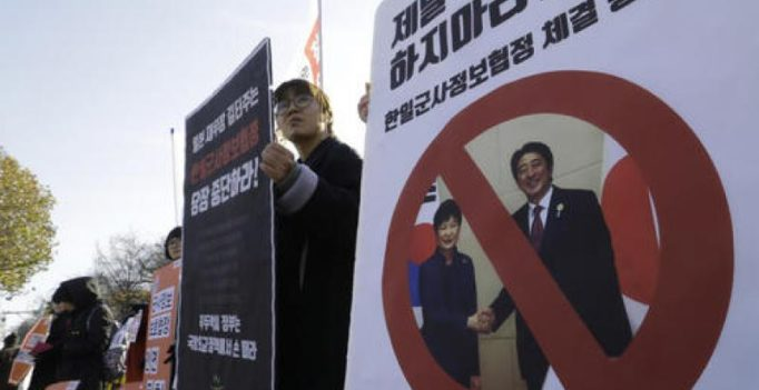 South Korea, Japan sign controversial intelligence deal