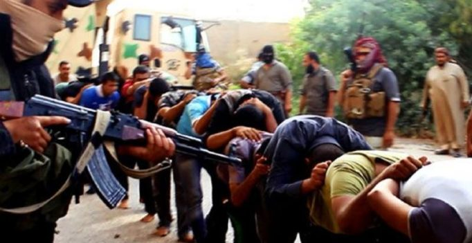 ISIS hangs 40 bodies from poles
