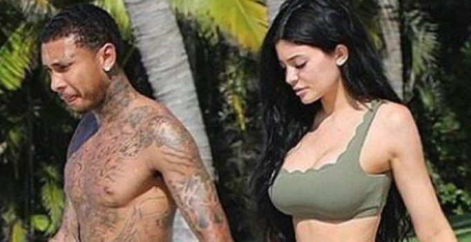 Kylie Jenner flaunts her curves and smooches her beau Tyga