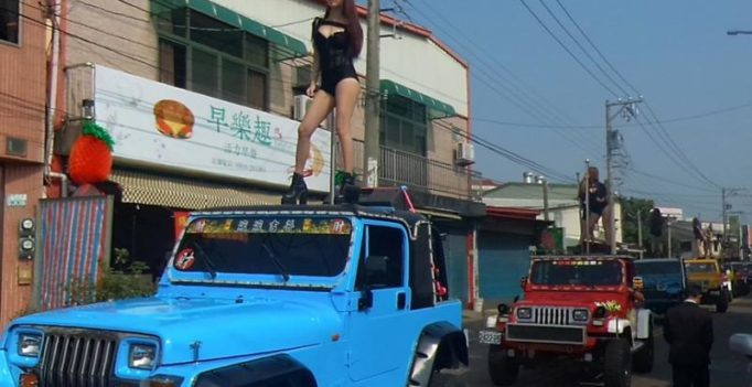Video: Pole dancers jam traffic at Taiwan politician's funeral