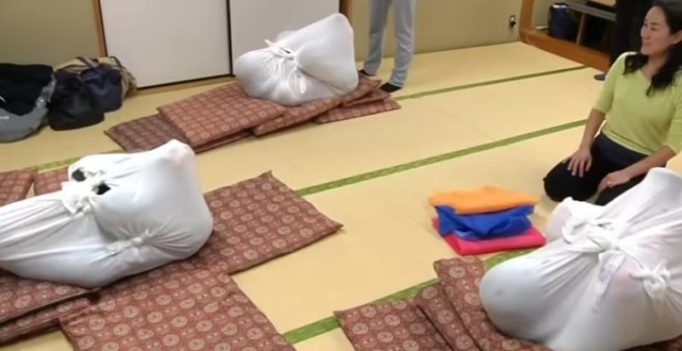 Adult swaddling therapy fad hits Tokyo