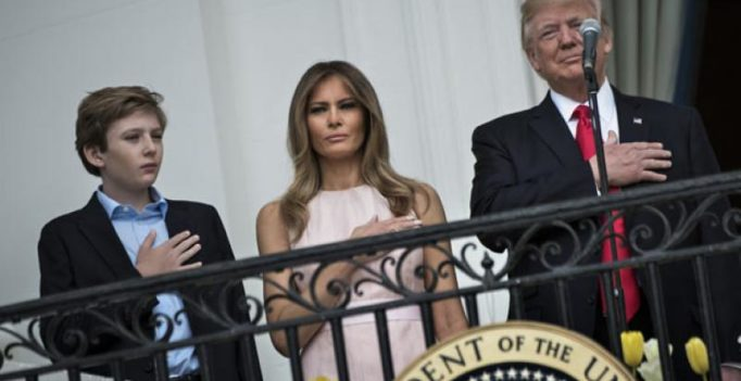 Video: First Lady Melania nudges President Trump during national anthem