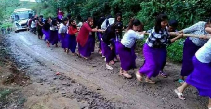 Image of Manipuri girls forming human chain to drag bus out of mud goes viral