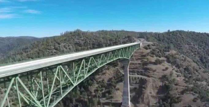 Woman falls off tallest California bridge while taking selfie, survives