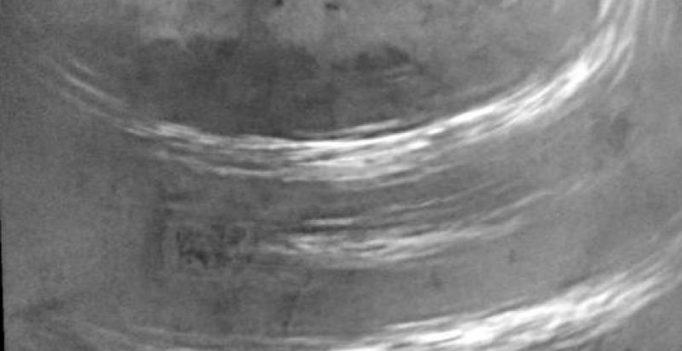 NASA's Cassini captures methane clouds drifting across Saturn's moon