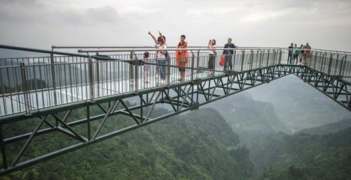 World's longest skywalk in China, with glass bottom, 400 feet above gaping gorge