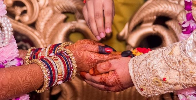 UP govt's 'shagun' to newly-weds include condoms, pregnancy test