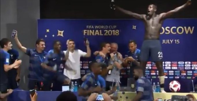 Watch: France players crash into post-match presser, spray champagne on Deschamps