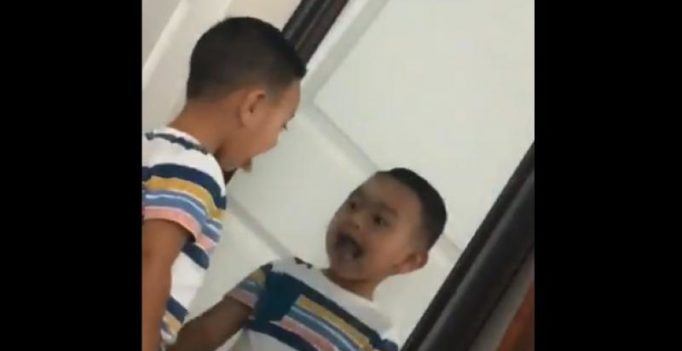In video: Shocking moment boy's reflection moves faster than him